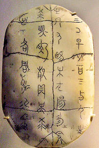 "Ancient Chinese characters on an ""oracle shell"", used to tell fortunes"