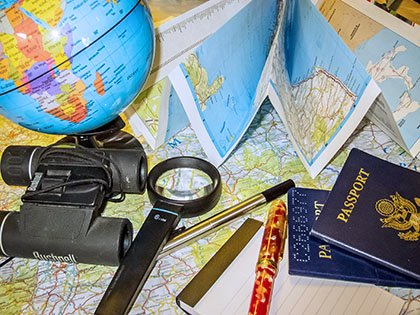 World travel - maps show you the places you'll go! Learn geography with free maps. Maps, globe magnifying glass, passport.